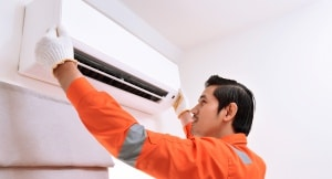 AC Technician inspecting Air Conditioner