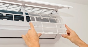AC Technician inspecting Air Conditioner 2